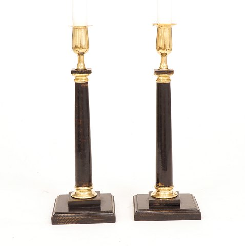A pair of wood candelsticks with brass mountings. 