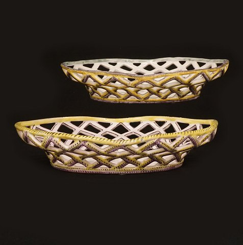 A pair of 18th century faience baskets. Signed 