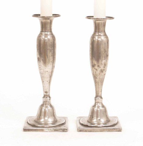 A pair of early 19th century pewter candlesticks. 