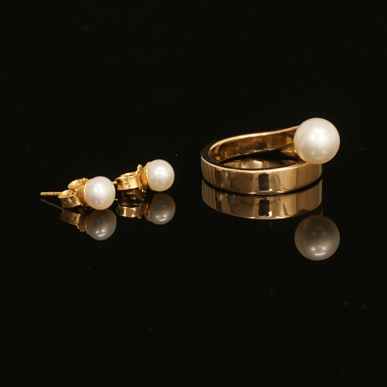 ørestikker med perler i guld